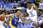 Pittsburgh guard Trey McGowens (2) dribbles the ball while North Carolina forward Armando Bacot (5) defends during the first half of an NCAA college basketball game in Chapel Hill, N.C., Wednesday, Jan. 8, 2020. (AP Photo/Gerry Broome)