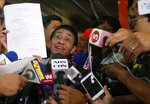 Maria Ressa, left, the award-winning head of a Philippine online news site Rappler that has aggressively covered President Rodrigo Duterte's policies, shows her release order after posting bail at a Regional Trial Court following an overnight arrest by National Bureau of Investigation agents on a libel case Thursday, Feb. 14, 2019 in Manila, Philippines. Ressa, who was selected by Time magazine as one of its Persons of the Year last year, was arrested over a libel complaint from a businessman which Amnesty International has condemned as