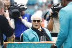 FILE - In this Dec. 22, 2019, file photo, former Miami Dolphins head coach Don Shula looks at a large cake celebrating the 1972 undefeated season and his birthday during half time at an NFL football game against the Cincinnati Bengals in Miami Gardens, Fla.  Shula, who won the most games of any NFL coach and led the Miami Dolphins to the only perfect season in league history, died Monday, May 4, 2020, at his South Florida home, the team said. He was 90. (AP Photo/Brynn Anderson, File)