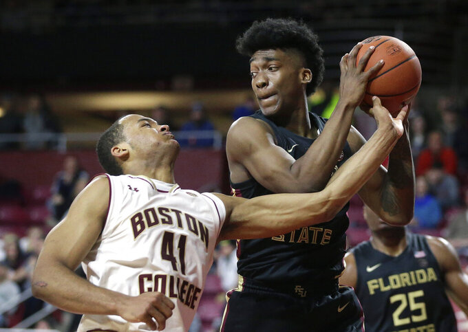 Boston College's Steffon Mitchell, left, tries to block Florida State's Terance Mann, right, in the second half of an NCAA college basketball game, Sunday, Jan. 20, 2019, in Boston. Boston College won 87-82. (AP Photo/Steven Senne)