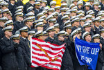 Navy Midshipmen support their team during an NCAA college football game against the Air Force at Falcon Stadium at the U.S. Air Force Academy, Saturday Oct. 6, 2018, in Colorado Springs, Colo.  (Dougal Brownlie,/The Gazette via AP)