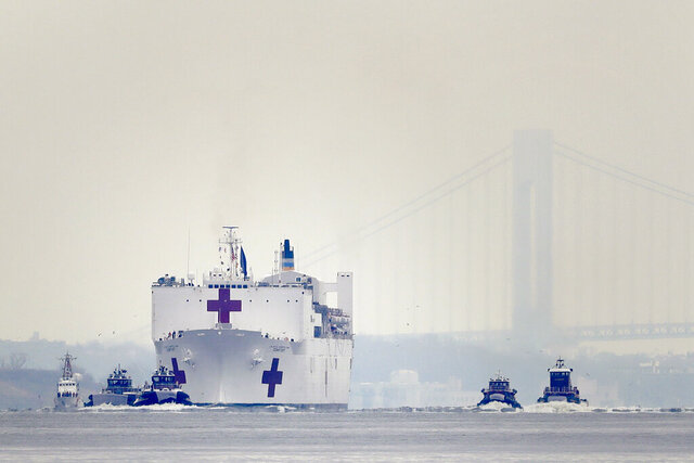 The Navy hospital ship USNS Comfort arrives in New York, Monday, March 30, 2020. The ship has 1,000 beds and 12 operating rooms that could be up and running within 24 hours of its arrival on Monday morning. It's expected to bolster a besieged health care system by treating non-coronavirus patients while hospitals treat people with COVID-19. (AP Photo/Seth Wenig)
