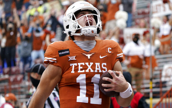 Texas quarterback Sam Ehlinger (11) reacts as he runs for a 17-yard touchdown against Iowa State during the first half of an NCAA college football game, Friday, Nov. 27, 2020, in Austin, Texas. (AP Photo/Eric Gay)