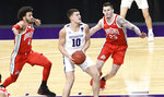 Northwestern forward Miller Kopp (10) drives to the basket as Ohio State forward Kyle Young (25) guards him during the second half of an NCAA college basketball game, Saturday, Dec. 26, 2020, in Evanston, Ill. (AP Photo/David Banks)