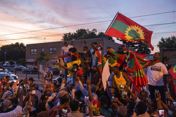 Members of the Oromo community stop during a protest on University Avenue in St. Paul, Minn., to sing a song by Hachalu Hundessa, Wednesday, July 1, 2020. Protesters apparently outraged by the killing of Hachalu Hundessa, a popular singer in Ethiopia, stopped traffic on an interstate during the evening rush hour, before leaving the highway and walking along surface roads. (Evan Frost/Minnesota Public Radio via AP)