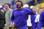 LSU head coach Ed Orgeron signals during the first half of an NCAA college football game against Mississippi in Baton Rouge, La., Saturday, Dec. 19, 2020. (AP Photo/Matthew Hinton)