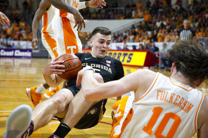 Florida State center Balsa Koprivica (5) and Tennessee forward John Fulkerson (10) hit the floor after a rebound in the second half of an NCAA college basketball game at the Emerald Coast Classic in Niceville, Fla., Friday, Nov. 29, 2019. (AP Photo/Mark Wallheiser)