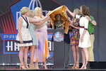 The Bowlen family unveil the bust of former Denver Broncos owner Pat Bowlen during the induction ceremony at the Pro Football Hall of Fame, Saturday, Aug. 3, 2019, in Canton, Ohio. (AP Photo/David Richard)