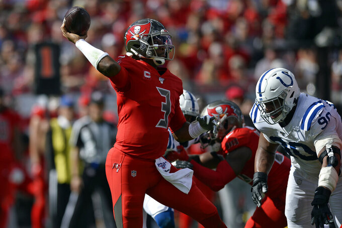Tampa Bay Buccaneers quarterback Jameis Winston (3) throws a pass as he is pressured by Indianapolis Colts defensive tackle Grover Stewart (90) during the first half of an NFL football game Sunday, Dec. 8, 2019, in Tampa, Fla. (AP Photo/Jason Behnken)