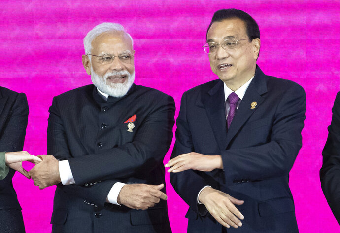 Indian Prime Minister Narendra Modi, left, and Chinese Premier Li Keqiang pose for a group photo at The Regional Comprehensive Economic Partnership Association of Southeast Asian Nations (ASEAN) summit in Nonthaburi, Thailand, Monday, Nov. 4, 2019. (AP Photo/Wason Wanichakorn)