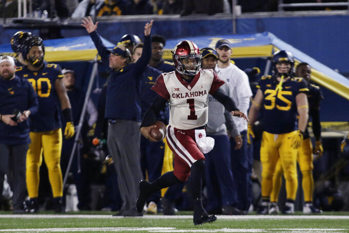 Oklahoma quarterback Kyler Murray (1) runs the ball for a touchdown during the first half of an NCAA college football game against West Virginia on Friday, Nov. 23, 2018, in Morgantown, W.Va. (AP Photo/Raymond Thompson)