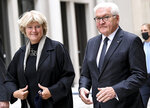Germany's President Frank-Walter Steinmeier, right, and Monika Grutters, Minister of State for Culture, attends the ceremony marking the exhibition opening of the Ethnological Museum, the Museum of Asian Art of the National Museums in Berlin/Prussian Cultural Heritage Foundation and the Humboldt Forum Foundation at the Berlin Palace, Berlin, Germany, Wednesday Sept. 22, 2021. (Britta Pedersen/dpa via AP)