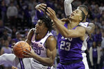Kansas State forward Xavier Sneed (20) is fouled by TCU forward Jaedon LeDee (23) during the first half of an NCAA college basketball game in Manhattan, Kan., Tuesday, Jan. 7, 2020. (AP Photo/Orlin Wagner)