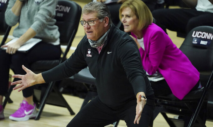 connecticut head coach Geno Auriemma watches from the sideline as the team takes on South Carolina in the first half of an NCAA college basketball game in Storrs, Conn., Monday, Feb. 8, 2021. (David Butler/Pool Photo via AP)