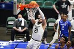 Colorado State guard David Roddy (21) gets through Louisiana Tech defenders to sink a basket late in the second half of an NCAA college basketball game in the NIT, Sunday, March 28, 2021, in Frisco, Texas. (AP Photo/Tony Gutierrez)