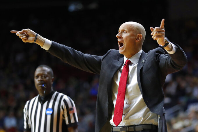 Louisville head coach Chris Mack directs his team during a first round men's college basketball game against Minnesota in the NCAA Tournament, Thursday, March 21, 2019, in Des Moines, Iowa. Minnesota won 86-76. (AP Photo/Charlie Neibergall)