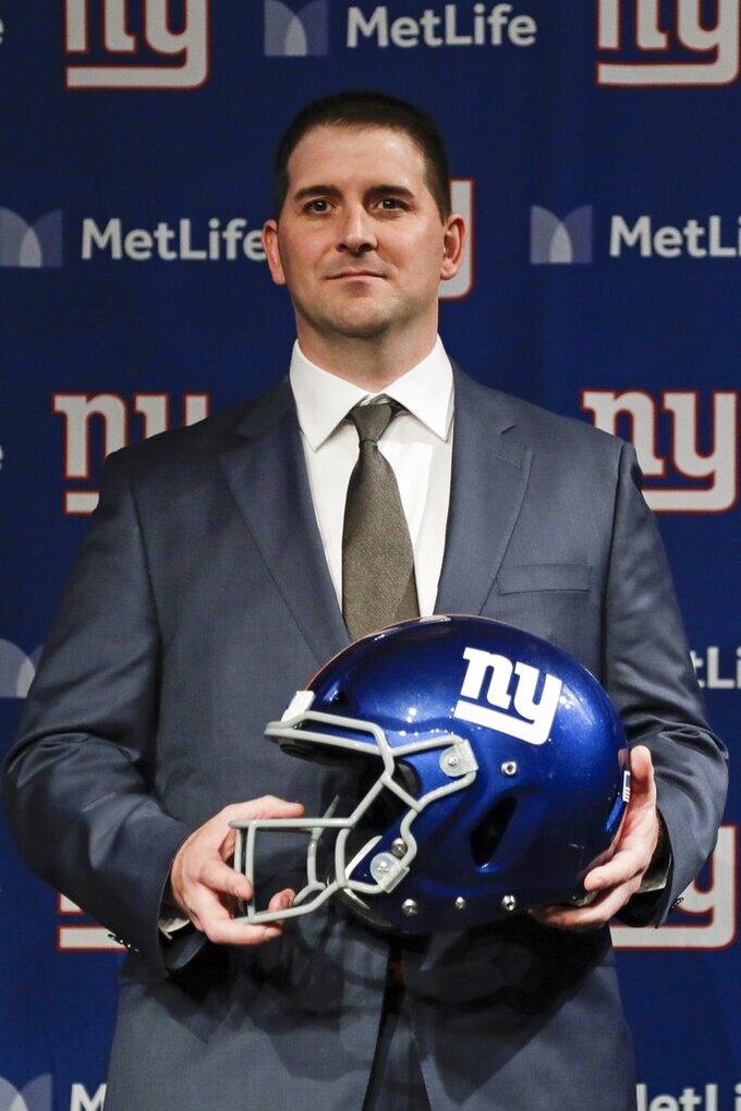 New York Giants new NFL football head coach Joe Judge, center, poses for photographs Thursday, Jan. 9, 2020, in East Rutherford, N.J. (AP Photo/Frank Franklin II)