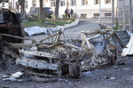 A view of a vehicle destroyed after shelling by Azerbaijan's artillery near a hospital, during a military conflict in front line city of Martakert, the separatist region of Nagorno-Karabakh, Monday, Oct. 19, 2020. New shelling has been reported in fighting between Armenia and Azerbaijan, violating a weekend cease-fire in the conflict over the separatist territory of Nagorno-Karabakh. Battles have raged for over three weeks. (AP Photo)