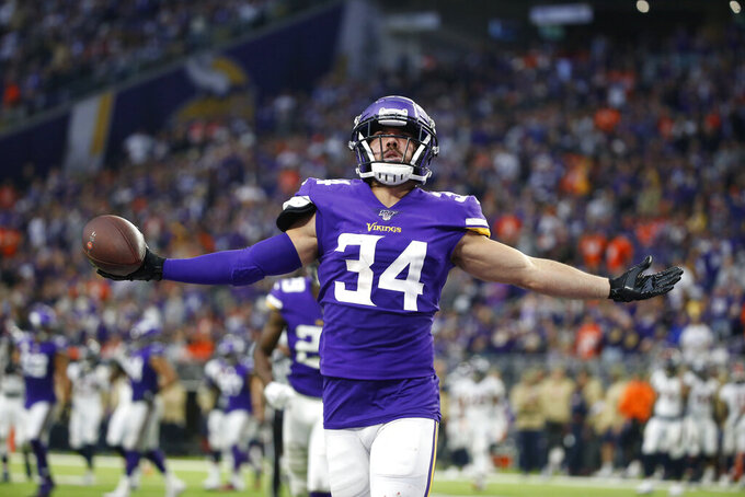 FILE - In this Nov. 17, 2019, file photo, Minnesota Vikings strong safety Andrew Sendejo celebrates after intercepting a pass during the first half of an NFL football game against the Denver Broncos in Minneapolis. The Cleveland Browns have added another veteran safety to their secondary, agreeing to terms with Andrew Sendejo on a one-year, $2.25 million contract. The 32-year-old Sendejo played for Minnesota and Philadelphia last season. (AP Photo/Bruce Kluckhohn, File)