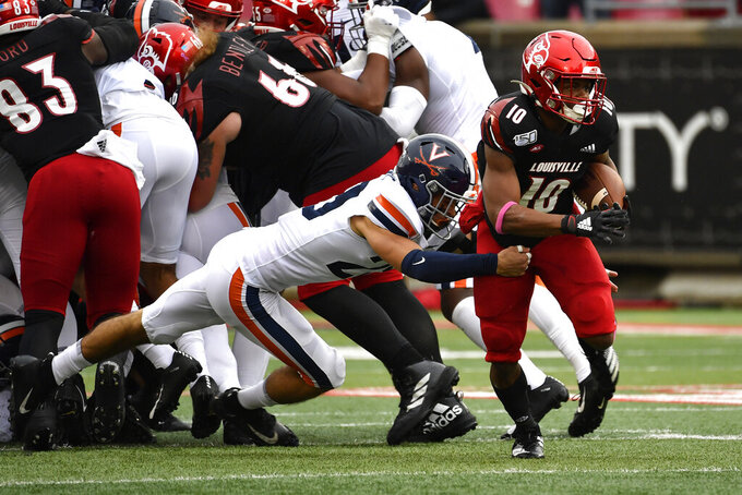 Virginia safety Joey Blount (29) attempts to bring down Louisville running back Javian Hawkins (10) during the first half of an NCAA college football game in Louisville, Ky., Saturday, Oct. 26, 2019. (AP Photo/Timothy D. Easley)
