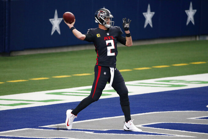 Atlanta Falcons quarterback Matt Ryan (2) warms up before an NFL football game against the Dallas Cowboys in Arlington, Texas, Sunday, Sept. 20, 2020. (AP Photo/Michael Ainsworth)