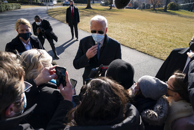 President Joe Biden talks with reporters after arriving on the South Lawn of the White House, Monday, Feb. 8, 2021, in Washington. (AP Photo/Evan Vucci)