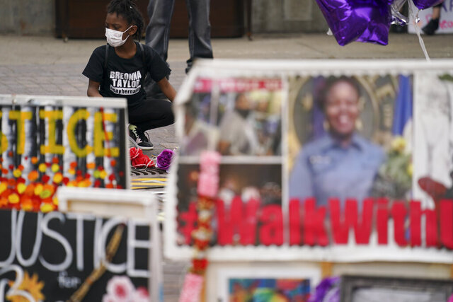People gather in Jefferson Square awaiting word on charges against police officers, Wednesday, Sept. 23, 2020, in Louisville, Ky. A grand jury has indicted one officer on criminal charges six months after Breonna Taylor was fatally shot by police in Kentucky. The jury presented its decision against fired officer Brett Hankison Wednesday to a judge in Louisville, where the shooting took place.(AP Photo/John Minchillo)