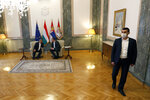 Serbian President Aleksandar Vucic, speaks with Hungarian Prime Minister Viktor Orban, left, during a meeting in Belgrade, Serbia, Friday, May 15, 2020. Orban is on a one-day official visit to Serbia. (AP Photo/Darko Vojinovic)