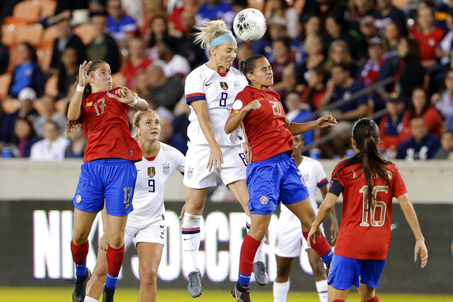 United States midfielder Julie Ertz (8) and Costa Rica midfielder Raquel Chacon (20) collide as they go for a header while Costa Rica forward Maria Salas (17), midfielder Lindsey Horan (9) and midfielder Katherine Alvarado (16) look on during the first half of a CONCACAF women's Olympic qualifying soccer match Monday, Feb. 3, 2020, in Houston. (AP Photo/Michael Wyke)