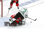 Dallas Stars' John Klingberg (3) is unable to get a shot off as he skates over Chicago Blackhawks goaltender Corey Crawford during the second period of an NHL hockey game Tuesday, Nov. 26, 2019, in Chicago. (AP Photo/Charles Rex Arbogast)
