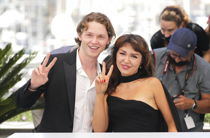 Mercedes Kilmer, right, and Jack Kilmer, children of actor Val Kilmer, pose for photographers at a photo call for the film 'Val' during the 74th international film festival, Cannes, southern France, Wednesday, July 7, 2021. (Photo by Vianney Le Caer/Invision/AP)