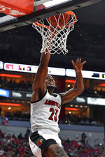 Louisville center Steven Enoch (23) makes a layup during the second half of an NCAA college basketball game  against Akron in Louisville, Ky., Sunday, Nov. 24, 2019. (AP Photo/Timothy D. Easley)