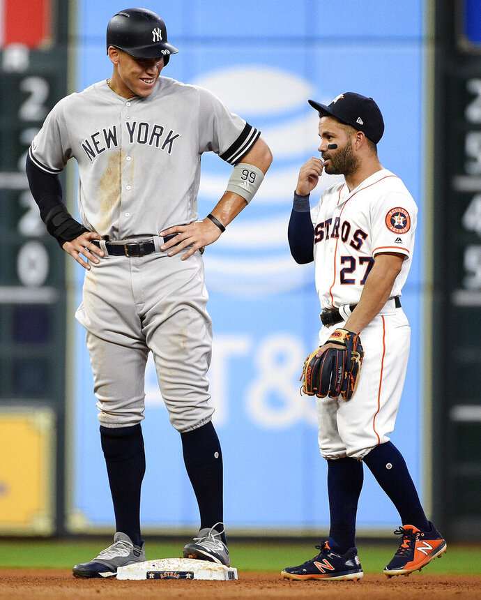 New York Yankees' Aaron Judge, left, talks with Houston Astros second baseman Jose Altuve during the seventh inning of a baseball game, Monday, April 8, 2019, in Houston. (AP Photo/Eric Christian Smith)