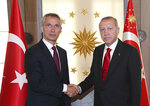 Turkey's President Recep Tayyip Erdogan, right, and NATO Secretary General Jens Stoltenberg shake hands before a meeting, in Ankara, Turkey, Monday, May 6, 2019. Stoltenberg is in Ankara for a working visit to Turkey in the framework of the 25th anniversary of the Mediterranean Dialogue. (Presidential Press Service via AP, Pool)