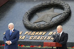 Russian President Vladimir Putin, right, and Belarusian President Alexander Lukashenko attend an opening ceremony of the monument to honour the World War II Red Army, in the village of Khoroshevo, just outside Rzhev, about 200 kilometers (about 125 miles) northwest of Moscow, Russia, Tuesday, June 30, 2020.  (Mikhail Klimentyev, Sputnik, Kremlin Pool Photo via AP)