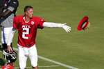 Atlanta Falcons quarterback Matt Ryan (2) tosses his hat to a staff member after stretching at an NFL football practice Tuesday, Aug. 18, 2020, in Flowery Branch, Ga. (AP Photo/John Bazemore, Pool)