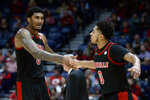 Louisville guard Lamarr Kimble (0) congratulates forward Malik Williams (5) after they were taken out of an NCAA college basketball game against Western Kentucky during the second half Friday, Nov. 29, 2019, in Nashville, Tenn. (AP Photo/Mark Zaleski)