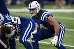 Indianapolis Colts tackle Anthony Castonzo (74) gets ready for the snap during an NFL football game against the Houston Texans on Sunday, Dec. 20, 2020, in Indianapolis. Castsonzo, the Colts longtime left tackle, announced his retirement Tuesday, Jan. 12, 2021. The 32-year-old had been an anchor on Indy's offensive line since he was the No. 22 overall draft pick in 2011.  (AP Photo/Zach Bolinger, File)