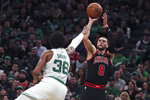 Chicago Bulls guard Zach LaVine (8) shoots over Boston Celtics guard Marcus Smart (36) during the second half of an NBA basketball game in Boston, Monday, Jan. 13, 2020. The Celtics defeated the Bulls 113-101. (AP Photo/Charles Krupa)