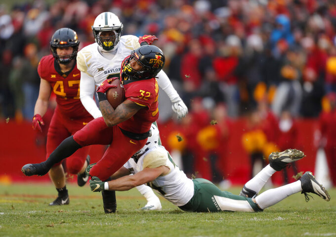Iowa State running back David Montgomery, front left, runs the ball as he is tackled by Baylor linebacker Clay Johnston, right, during the first half of an NCAA college football game, Saturday, Nov. 10, 2018, in Ames. (AP Photo/Matthew Putney)