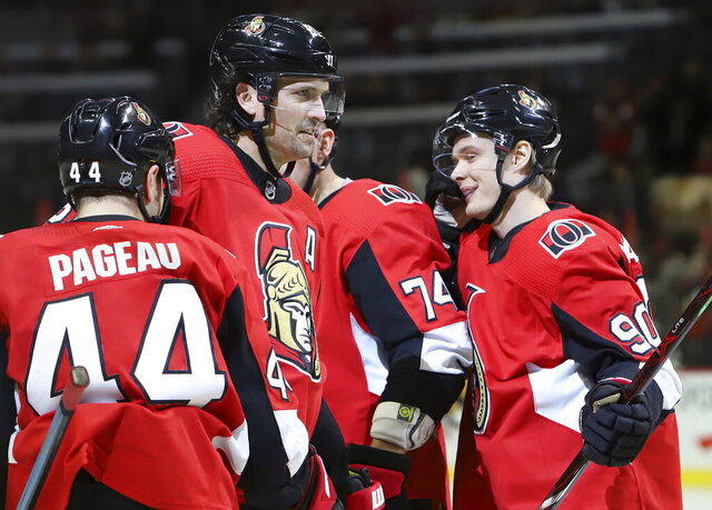 Ottawa Senators left wing Vladislav Namestnikov (90) celebrates his goal with teammates Jean-Gabriel Pageau (44), Ron Hainsey (81) and Mark Borowiecki (74) during the second period of an NHL hockey game against the Nashville Predators on Thursday, Dec. 19, 2019, in Ottawa, Ontario. (Fred Chartrand/The Canadian Press via AP)