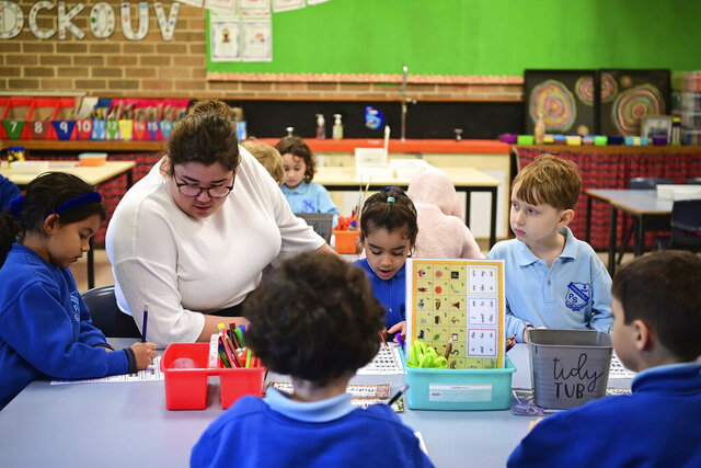 Kindergarten students work on an activity at Annandale Public School in Sydney, Monday, May 25, 2020. Students in two more Australian states returned to school full-time as numbers of COVID-19 patients in hospitals across the country fall. (Joel Carrett/AAP Image via AP)