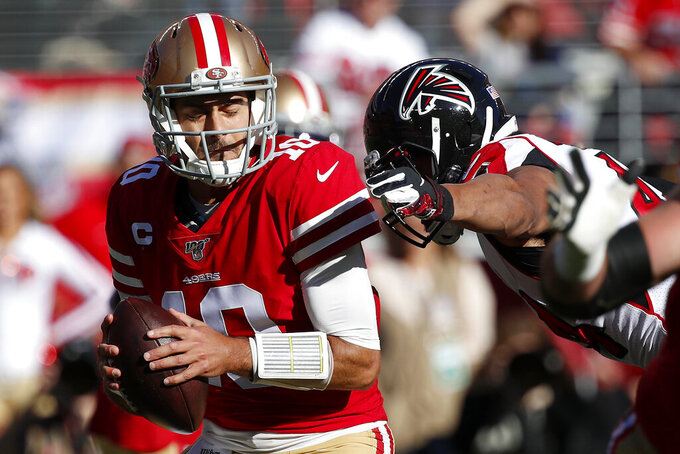 Atlanta Falcons defensive end Vic Beasley, right, reaches to sack San Francisco 49ers quarterback Jimmy Garoppolo during the first half of an NFL football game in Santa Clara, Calif., Sunday, Dec. 15, 2019. (AP Photo/Josie Lepe)