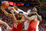 Ohio State's Keyshawn Woods (32) wins a rebound in front of C.J. Jackson, right front, Nebraska's Tanner Borchardt, center rear, and Nana Akenten, right rear, during the first half of an NCAA college basketball game in Lincoln, Neb., Saturday, Jan. 26, 2019. (AP Photo/Nati Harnik)