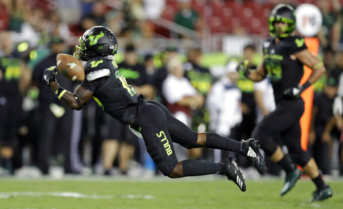 South Florida wide receiver Jernard Phillips cannot hang onto a pass during the second half of an NCAA college football game against Temple, Thursday, Nov. 7, 2019, in Tampa, Fla. (AP Photo/Chris O'Meara)