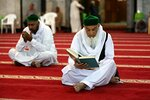 Muslim worshippers read the Quran, Islam's holy book, at Abdul-Qadir al-Gailani mosque in Baghdad, Iraq, Wednesday, May 16, 2018. Muslims throughout the world are preparing to celebrate Ramadan, the holiest month in the Islamic calendar, refraining from eating, drinking, smoking and sex from sunrise to sunset. (AP Photo/Karim Kadim)