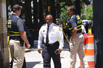 Atlanta Police Chief Rodney Bryant arrives at the scene of a shooting, Wednesday, June 30, 2021, in Atlanta. Two police officers responding to reports of gunfire in one of Atlanta's most famous neighborhoods were ambushed Wednesday, leaving one of them shot and wounded and a suspect dead, authorities said. (Ben Gray/Atlanta Journal-Constitution via AP)