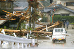 Debris are seen on a residential area hit by heavy rain in Kumamura, Kumamoto prefecture, southern Japan Tuesday, July 7, 2020. Rescue operations continued and rain threatened wider areas of the main island of Kyushu. (Kota Endo/Kyodo News via AP)