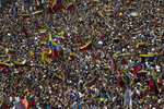Anti-government protesters take part in a demonstration demanding the resignation of President Nicolas Maduro, in Caracas, Venezuela, Saturday, Feb. 2, 2019. Momentum is growing for Venezuela's opposition movement led by lawmaker Juan Guaido, who has called supporters back into the streets for nationwide protests Saturday, escalating pressure on Maduro to step down. (AP Photo/Rodrigo Abd)