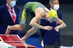Emma McKeon of Australia starts in a women's 100-meter freestyle semifinal at the 2020 Summer Olympics, Thursday, July 29, 2021, in Tokyo, Japan. (AP Photo/Matthias Schrader)